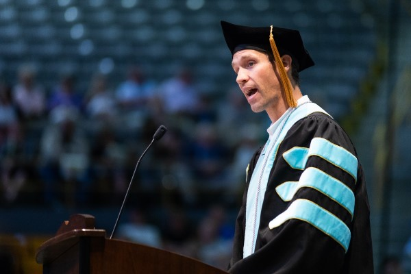 Dr. Nate Weigl speaking at Spring 2018 RCOE Commencement
